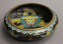 A Chinese bronze and cloisonne bowl, the underside with four character mark. 20 cm diameter.