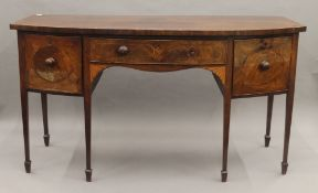 A 19th century mahogany inlaid bow front sideboard. 178 cm wide.