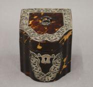 A Victorian silver mounted tortoiseshell tea caddy. 10 cm high.