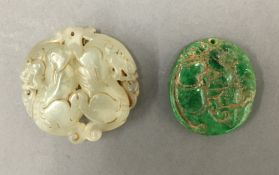Two Chinese jade pendants. The largest 5 cm diameter.