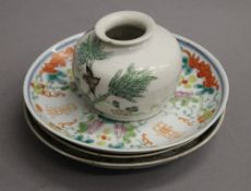Three 19th century Chinese porcelain dishes and a small 19th century porcelain vase.
