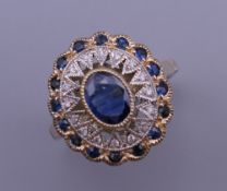 An Art Deco style 9 ct gold oval sapphire and diamond ring. Ring size N/O. 4.3 grammes total weight.