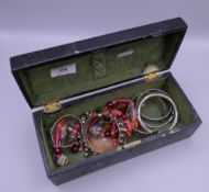 A quantity of miscellaneous jewellery in a lacquered box.