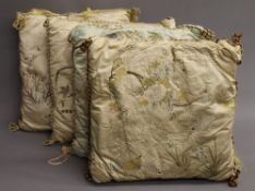 Four Chinese embroidered silk cushions. 43 x 46 cm.