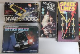 Astro Wars console game, and a similar Galaxy Invader game, both boxed, Mastermind and Spaceline