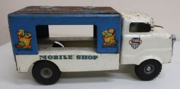 Tri-ang tinplate mobile shop, with white cab and blue body (length 36cm)