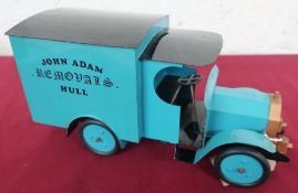 Tinplate clockwork model of an early 20th century removal van, blue body with black roof, for John