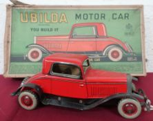 A Ubilda tin plate clockwork motorcar by Chad Valley (25cm), with spanner and two spare nuts and