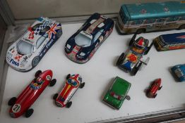 Collection of friction and clock work tin plate model vehicles including GTP motorways coach, SAS