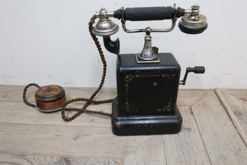 Early railway telephone, black body with gilt detail and hand crank, with test label to interior (