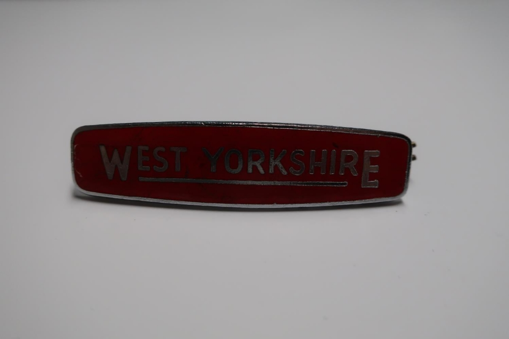 West Yorkshire red enamel cap badge