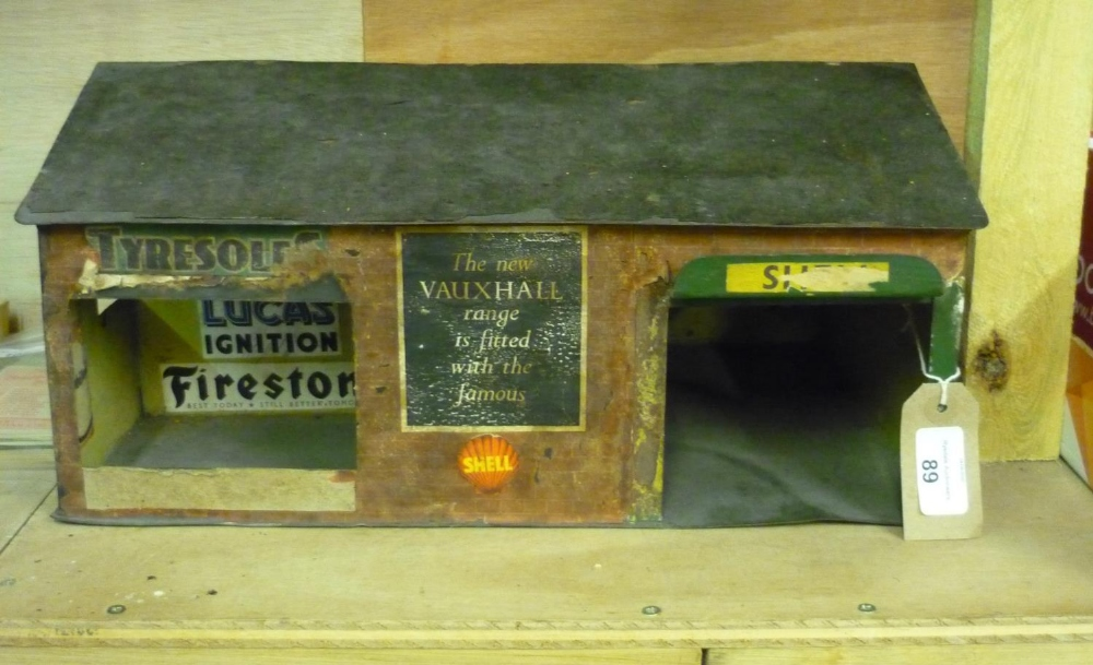 Tinplate garage workshop building, with brick effect and Vauxhall, Shell, Firestone advertising (
