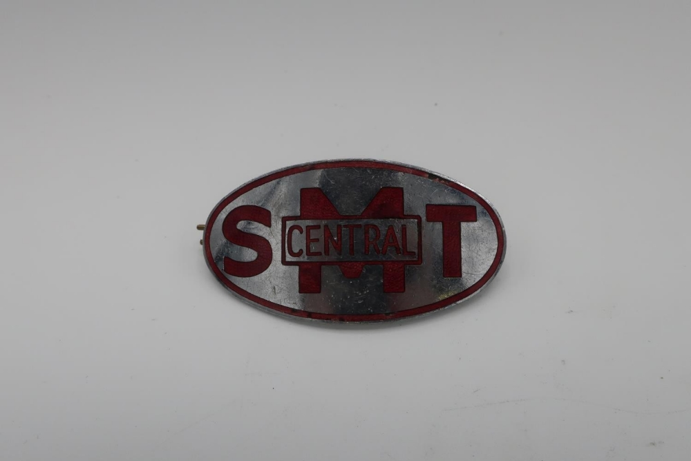 Central SMT oval enamel cap badge