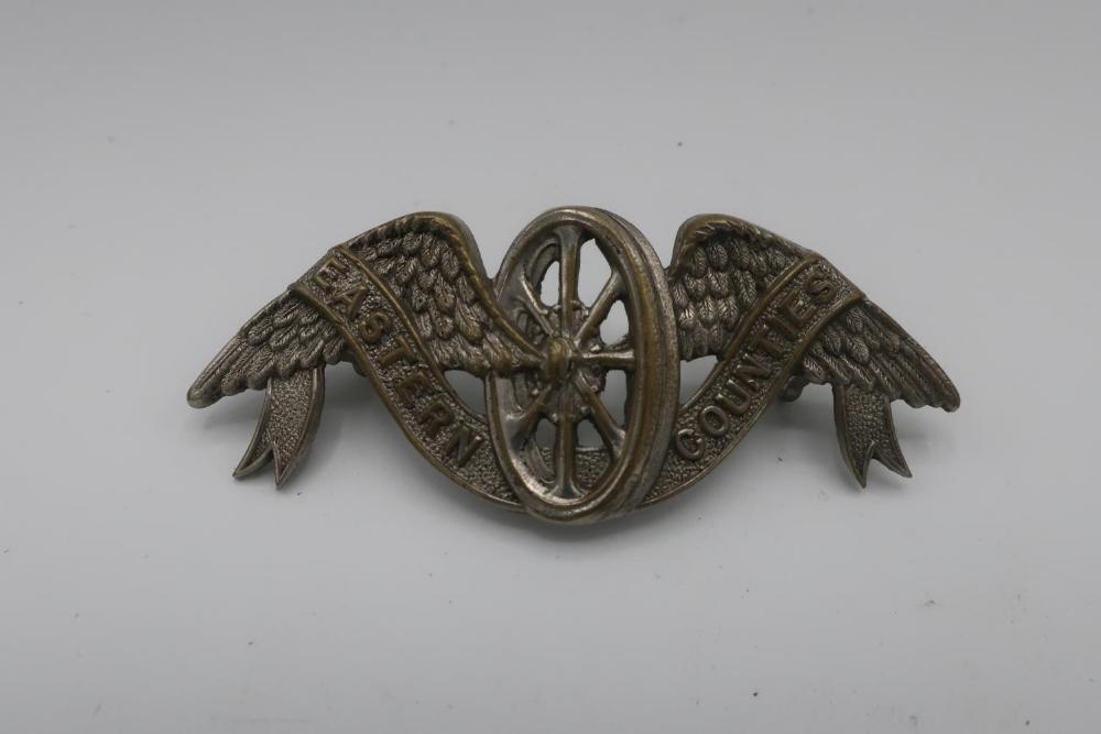 Eastern Counties Winged Wheel white metal cap badge