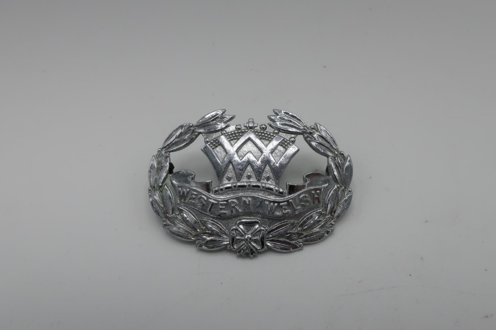 Western Welsh chrome cap badge