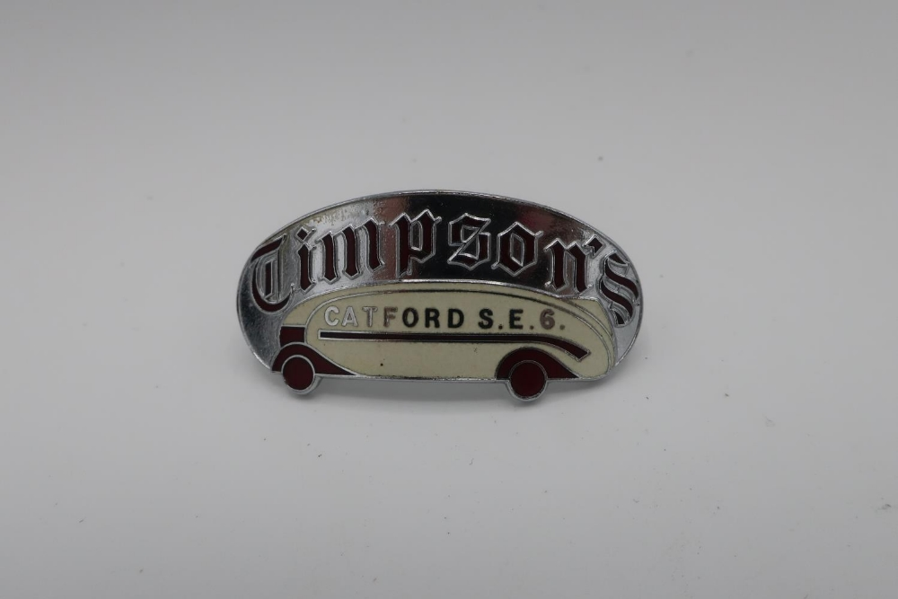 Timpson's Catford S.E.6. oval enamel cap badge