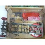 Part finished Meccano model of a car, and a quantity of green Meccano (two boxes)