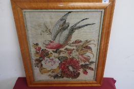 Late Victorian needlework panel depicting a parakeet perched on a branch surrounded by exotic