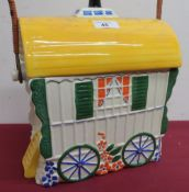 Old Romany bone china biscuit barrel in the shape of a bow top gypsy caravan, with wicker bound