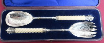 Pair of Victorian EPNS salad servers, with barley twist ivory turned handles and crown finials, in