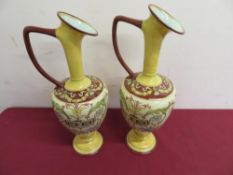 Pair of Doulton Lambeth faience (1872) floral decorated vases with three artist marks to the