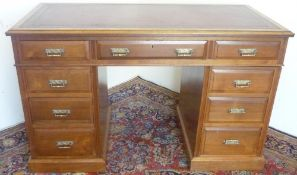 Edwardian walnut pedestal desk, figured top with inset gilt tooled red leather writing surface above