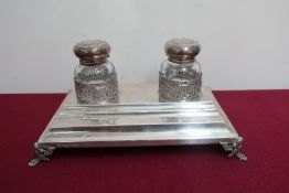 20th C continental silver rectangular inkstand, the two clear glass wells with hinged silver tops,