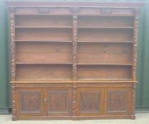 Large Victorian carved oak library bookcase, raised back with moulded cornice, mask and scroll