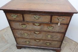18th C cross and feather banded walnut chest with moulded top above three short and three long