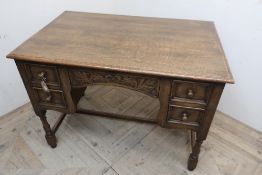 17th C style oak kneehole desk, hinged top with fitted interior above two real and two faux