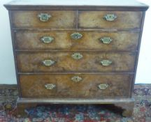 18th C crossbanded figured walnut chest of two short and three long graduated drawers, with