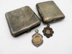 Geo. V silver cigarette case, Birmingham 1929, an EPNS cigarette case, two silver fobs