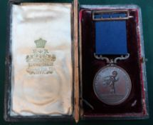 Cased bronze life saving medal awarded to William T. Morgan, May 20.1907