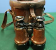 Cased pair of leather bound binoculars the case marked with binocular prismatic No6 case Mk1 with