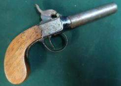Percussion cap pocket pistol with 2 3/4 inch turn off barrel and engraved scrollwork detail to