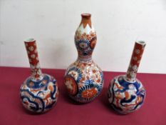 A pair of Japanese Imari pattern mallet shaped vases (H18cm), similar double gourd shaped vase. (