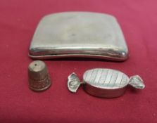Small box in the form of a wrapped boiled sweet, stamped CME 925, Geo.V engine turned silver curved