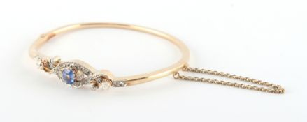 A late 19th / early 20th century 14ct yellow gold sapphire & diamond hinged bangle, the octagonal