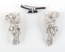 A good diamond double clip brooch in the form of a pair of floral sprays, the estimated total