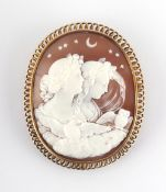 A large oval shell cameo brooch emblematic of night with two classical female figures, an eagle