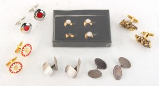 Property of a deceased estate - a bag containing cufflinks & studs including two pairs of silver