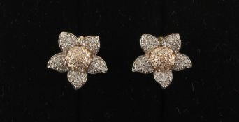 Property of a deceased estate - a 14ct white & yellow gold diamond flowerhead cluster earrings, with