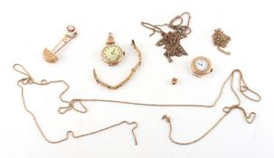 Property of a lady - a bag containing assorted items including two lady's 9ct gold cased