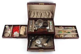 Property of a deceased estate - a domed red leather jewellery box containing costume jewellery,