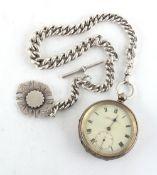Property of a deceased estate - a silver key wind pocket watch on heavy silver curb link albert