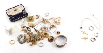 Property of a deceased estate - a bag containing assorted jewellery including three gold rings,