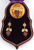 A Victorian garnet vine & grapes brooch & earrings suite or demi parure, with oval cut garnets,