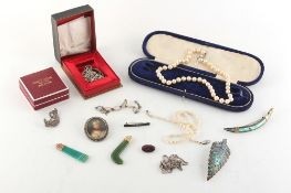 Property of a lady - a bag containing assorted jewellery including a John Hart silver Iona brooch