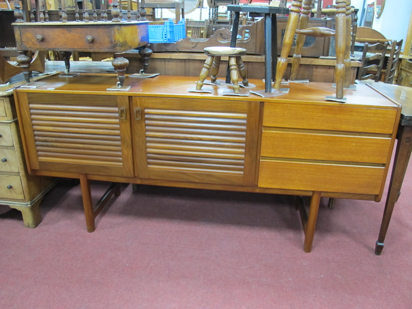 Lot 934 - McIntosh Teak Sideboard, with twin louvre type doors and right flight of three drawers, 170cm wide.