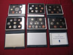 Six Royal Mint United Kingdom Proof Coin Collections, 1983, 1984, 1985, 1991, 1993 and 1997, all